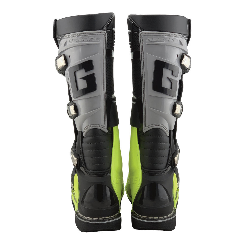 GAERNE GX-1 черно-желтого цвета спортивные сапоги для мотокросса, вид сзади купить по низкой цене